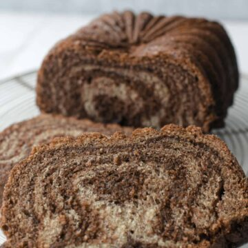 Banana Nutella Swirl Bread on cooling rack cut in slices