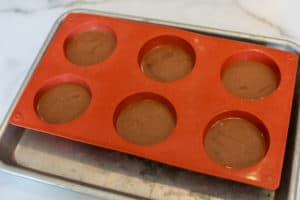 6 cavities on a small baking sheet, ½ way full of chocolate nutella mousse