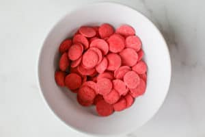 Red candy melts in a white bowl