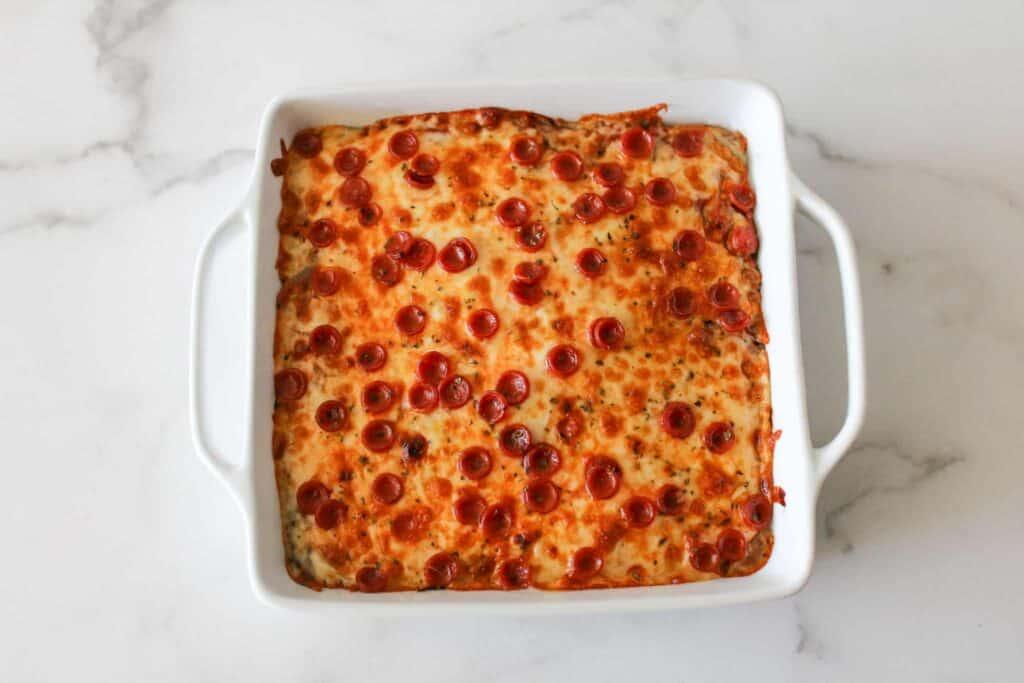 Overhead of Stuffed Mozzarella Pizza Cake in a 9x9 Casserole Dish