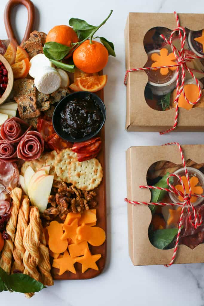 overhead of half of the Trader Joe's Winter Cheese & Charcuterie Board and the half of 2 grazing boxes