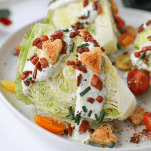 BLT Wedge Salad with Heart Croutons featured image of salad close up with 1 wedge angled