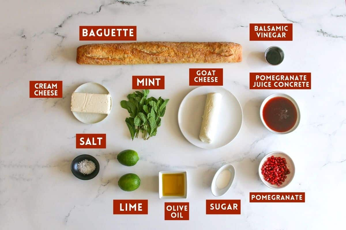 Ingredients on a white marble background. Each ingredient is labeled with a red box with white text in all caps.